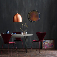 Fritz Hansen Gam Fratesi Copper Suspence Chairs in room with Burgandy La La Berlin Series 7 Chairs