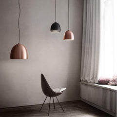Fritz Hansen Gam Fratesi Suspence Pendants Copper and Black in room with Arne Jacobsen Drop Chair