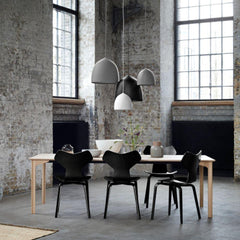 Fritz Hansen Gam Fratesi Suspence Pendants Black White Grey in loft with Grand Prix Chairs and Grand Prix Dining Table