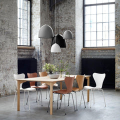 Fritz Hansen Gam Fratesi Suspence Pendants in loft with nude Series 7 chairs and Grand Prix Dining Table