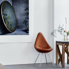 Fritz Hansen Leather Drop Chair in room with Ikebana Vase and Objects Mirror