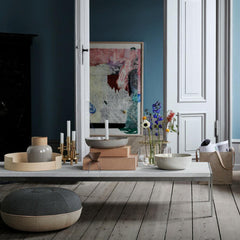 Fritz Hansen Pouf by Cecilie Manz in room with Poul Kjaerholm Coffee Table and Ikebana Vase