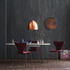 Fritz Hansen Lala Berlin Series 7 Chairs in room with Super Elliptical Dining Table
