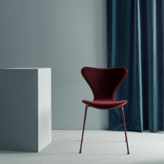 Fritz Hansen Lala Berlin Series 7 Barberry Red Velvet in room with Blue Curtain