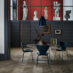 Fritz Hansen Lala Berlin Series 7 Chairs in room with Poul Kjaerholm Dining Table and Caravaggio Light Pendant