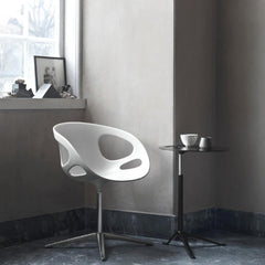 Fritz Hansen Little Friend Table in room with Ro Chair