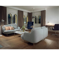 Fritz Hansen Lune Sofas by Jaime Hayon in room with Poul Kjaerholm Coffee Table, Ro Chair, and Oxford Chair