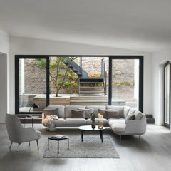 Fritz Hansen Fri Chair in room with Lune Corner Sectional Sofa by Jaime Hayon