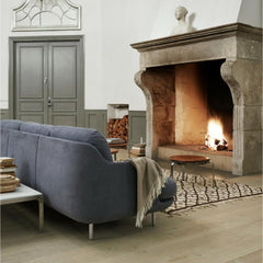 Fritz Hansen Lune Sofa by Jaime Hayon JH300 in room with Cozy Fireplace