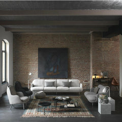 Fritz Hansen Join Coffee Table Round in Room with Lune Sofas and Fri Chairs