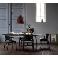 Fritz Hansen Nendo N01 Chairs in room with Caravaggio Pendant Light and Super Elliptical Dining Table