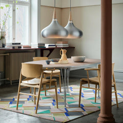 Fritz Hansen Nendo N01 Dining Chairs in room with Orient Pendant Lights and Super Elliptical Dining Table