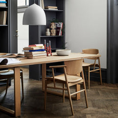 Fritz Hansen Nendo Dining Chairs in Oak in room with Cecilie Manz Essay Table