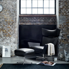 Fritz Hansen Oksen Chair and Ottoman by Arne Jacobsen in Black Leather in Room