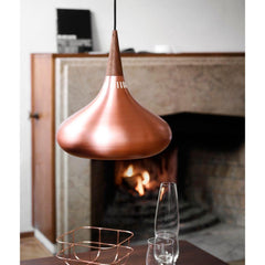 Fritz Hansen Orient Pendant Light Copper in dining room with Fireplace