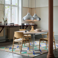 Fritz Hansen Orient Pendant Lights in dining room with Nendo N01 chairs and Super Elliptical Dining Table