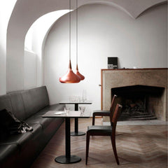 Fritz Hansen Copper Orient Pendant Lights in Cafe with Fireplace