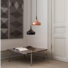 Fritz Hansen Orient Pendant Lights in room with Poul Kjaerholm Coffee Table