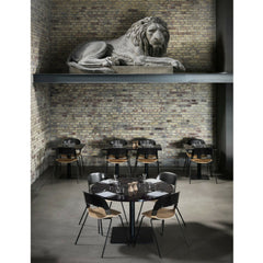 Fritz Hansen PAIR chairs by Benjamin Hubert Black and Oak in Elegant Restaurant with Lion Statue