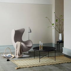Fritz Hansen Paul McCobb Planner Coffee Table in room with Egg Chair