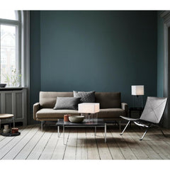 Lissoni Sofa in room with Poul Kjaerholm furniture collection by Fritz Hansen