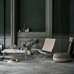 Fritz Hansen Pouf by Cecilie Manz in room with Poul Kjaerholm PK22 Chair and Coffee table