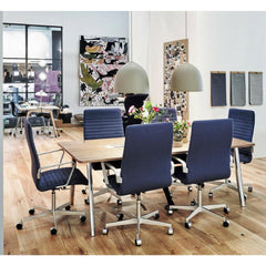 Fritz Hansen Premium Oxford Chairs in Room with Pluralis Table Stockholm