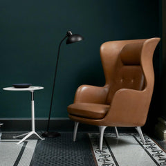 Fritz Hansen Ro Chair Leather in room with Little Friend Table and Kaiser Idell Floor Lamp