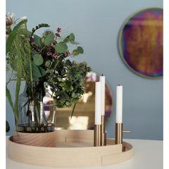 Fritz Hansen Mirror by Studio Roso styled in room with tray and candleholders