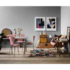 Fritz Hansen Table Series Super elliptical dining table in room with Pink Series 7 Chairs