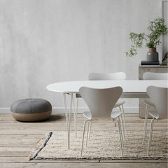 Fritz Hansen Super Elliptical Table Monochrome White in room with Series 7s and Cecile Manz Pouf