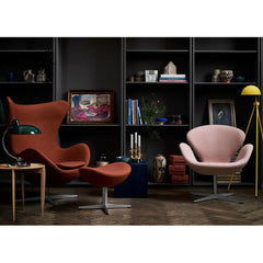 Fritz Hansen Arne Jacobsen Egg Chair and Footstool in Dark Orange in room with Light Pink Swan Chair