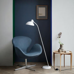 Fritz Hansen Swan Chair Dark Blue in Room with Kaiser Idell Floor Lamp