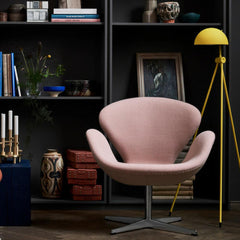 Fritz Hansen Swan Chair in pale pink wool in room with yellow Lightyears Floor Lamp