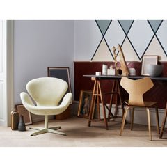 Fritz Hansen Swan Chair in room with Grand Prix Chair
