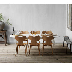 Fritz Hansen Grand Prix Chairs in Room with Super Elliptical Dining Table Arne Jacobsen