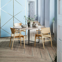 Fritz Hansen Nendo N01 Dining Chairs in Room with round marble Poul Kjaerholm Table