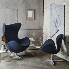 Fritz Hansen Egg and Swan Chairs Dark Blue in room with Art