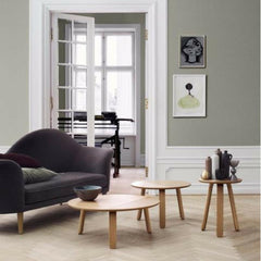 Gamfratesi Paper Table Collection in Oak with Gubi Olsen's Grand Piano Sofa by GUBI