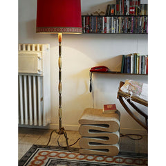 Gehry Wiggle Stool in Room with Red Lamp Vitra