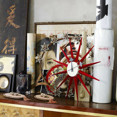 Red Sunburst Clock in Room George Nelson Vitra