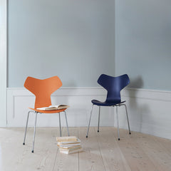 Grand Prix Chairs in Colors in Room with Books Arne Jacobsen Fritz Hansen