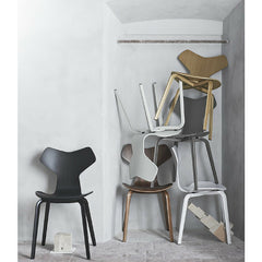 Grand Prix Chairs with Wood Legs Stacked in Room Arne Jacobsen Fritz Hansen