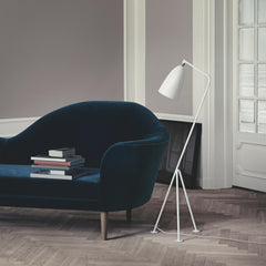 Grasshopper Floor Lamp by Greta Grossman with the Grand Piano Sofa by Gubi Olsen