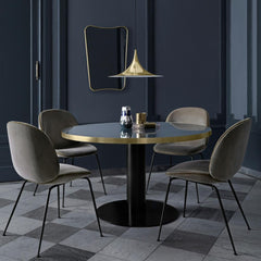 Gubi Brass Semi Pendant in Room with Grey Velvet Beetle Chairs