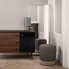 GUBI Gio Ponti F.A.33 Mirror in room with ABC Table Lamp and fringe Pouffe