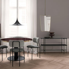 GUBI Gio Ponti F.A.-33 Wall Mirror in room with Coco Chairs and TS Console