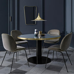 GUBI Gio Ponti F.A.-33 Wall Mirror in room with Semi Pendant and Beetle Dining Chairs