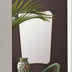 GUBI Gio Ponti F.A.-33 Wall Mirror in situ with plant