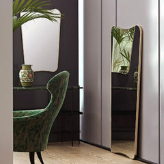 GUBI Gio Ponti F.A.-33 Wall Mirrors in room with Eva Lounge Chair
